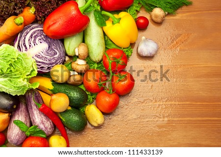 Composition of fresh Organic Vegetables /  with Water Drops / on the Wooden Desk - stock photo
