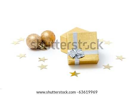 Composition of golden Christmas ornaments (giftbox and spheres) - stock photo