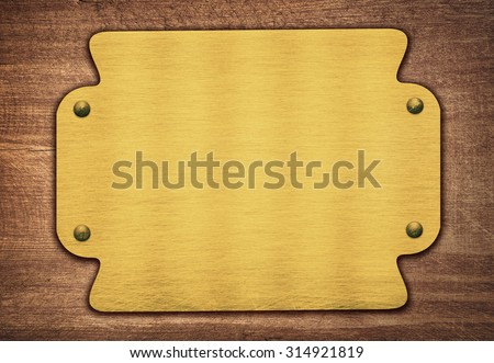 Composition of golden plaque, name plate on wooden plank