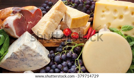 Composition of ham, cheese mixed with grapes, garlic, tomatoes and hot peppers
