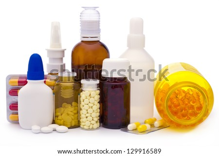 Composition of medicine bottles and pills isolated on white - stock photo