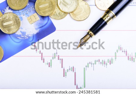 Composition of money, pen and financial charts - stock photo