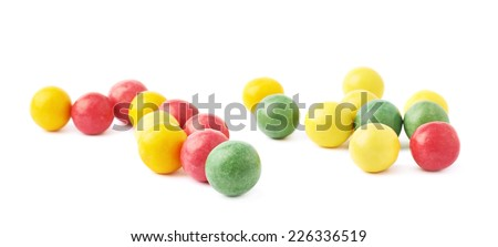 Composition of multiple chewing gum balls isolated over the white background - stock photo