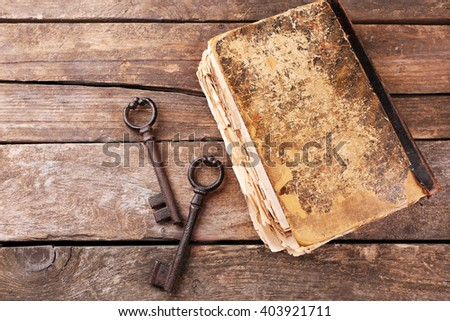 Composition of old books, keys and other things on wooden background, close up - stock photo