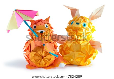 Composition of origami figures (hare, hedgehog, fox) isolated on white, with shadow - stock photo