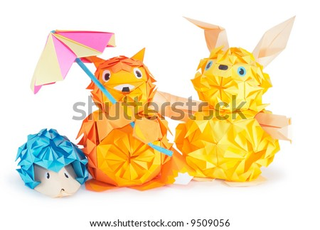 Composition of origami figures (hare, hedgehog, fox) isolated on white (with shadows and clipping path) - stock photo