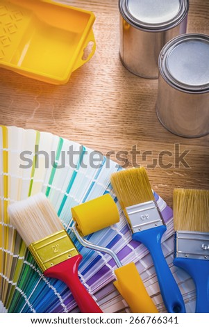 composition of painting tools paint brush roller tray can color palette on wooden board  - stock photo