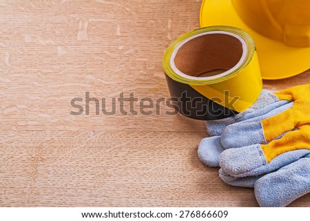 Composition of safety objects on wooden brown board construction concept  - stock photo