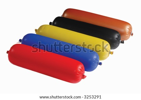 Composition of sausages in different color coating - stock photo