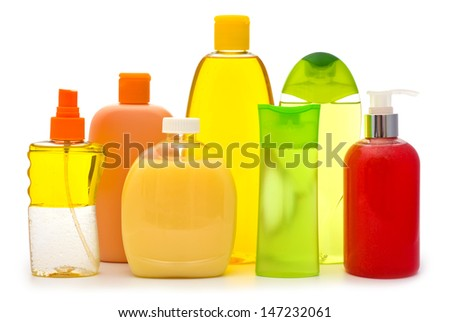 Composition of shampoo bottles and soap dispensers isolated on white background - stock photo