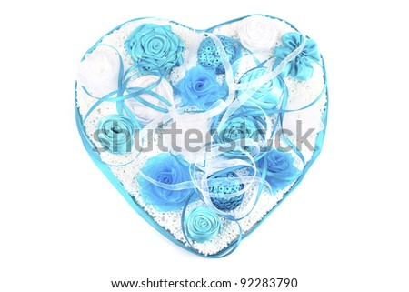 composition of silk flowers in the form of a heart