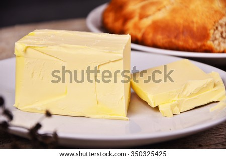 Composition of sliced of round of fresh home made bread with butter.