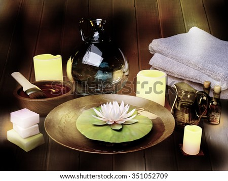 Composition of spa treatment, candles, lotus in bowl with water on wooden background. - stock photo