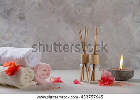 Composition of spa treatment on table on stone background, selective focus - stock photo