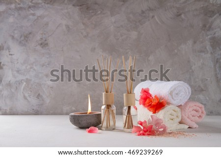 Composition of spa treatment on table on stone background, selective focus
