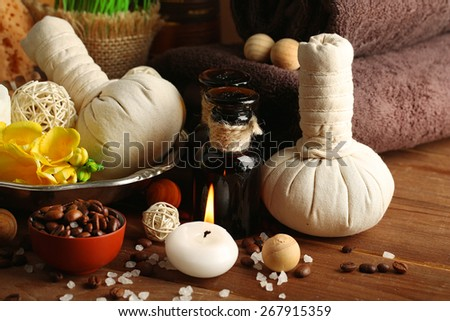 Composition of spa treatment on wooden table background - stock photo