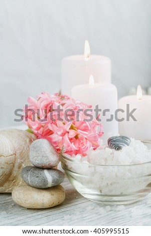 Composition of spa treatment with salt on wooden background - stock photo
