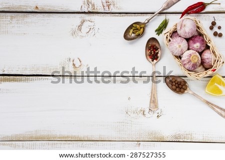 Composition of Spices. Herbs and spices selection - old metal spoons and white wooden background. Cooking, food or health concept. - stock photo