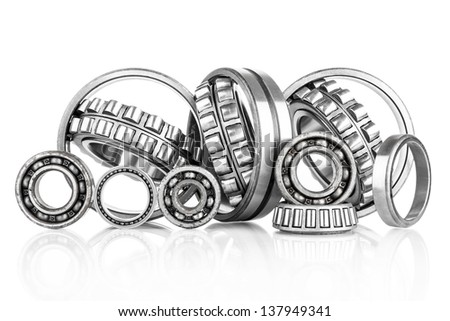 Composition of steel ball roller bearings in closeup isolated on white background - stock photo