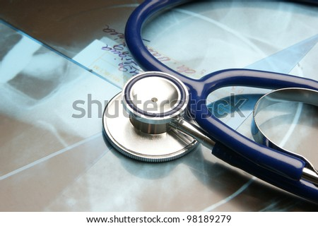 Composition of stethoscope and x-ray image - stock photo