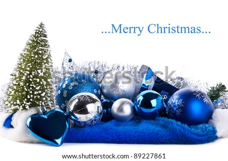 composition of the blue christmas balls and fir-tree isolated on a white background