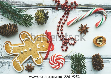 Composition of traditional food, sweets and other Christmas symbols on white wooden background