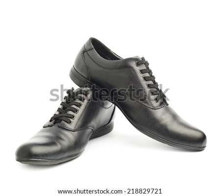 Composition of two classic black leather shoes isolated over the white background