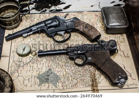 composition of two revolvers on the map - stock photo