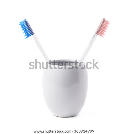 Composition of two toothbrushes - stock photo