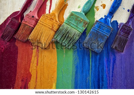 Composition of 6 used multi colored paintbrushes