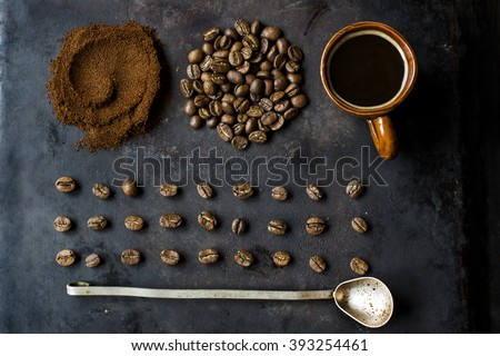 Composition of various coffee beans and coffee cups. Rustic still life. Top view - stock photo