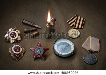 composition of Victory Day. orders, medals, compass, lighter, live ammunition. May 9. 1945 - stock photo