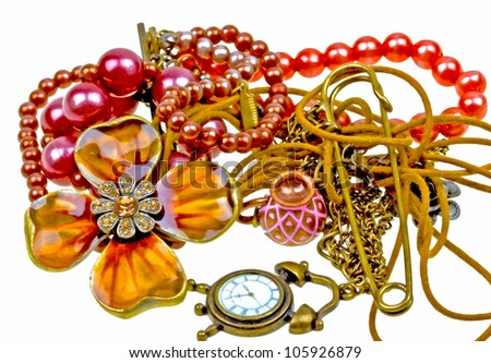 composition of vintage embelishments: string of beads, chain, pendant, watch  isolated on white background - stock photo
