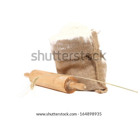 Composition of wheat flour in sack. Isolated on a white background. - stock photo