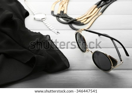Composition of woman's fashion look on wooden background - stock photo