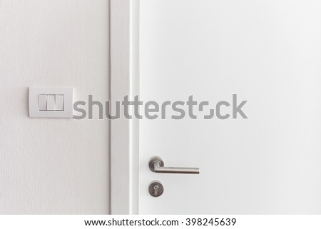 Composition of wooden door and white wall - stock photo