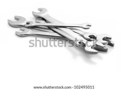Composition of wrenches on white background, with clipping paths - stock photo