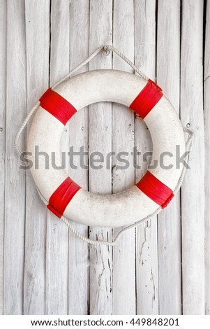 Composition on the marine theme with lifeline on old white wooden background - stock photo