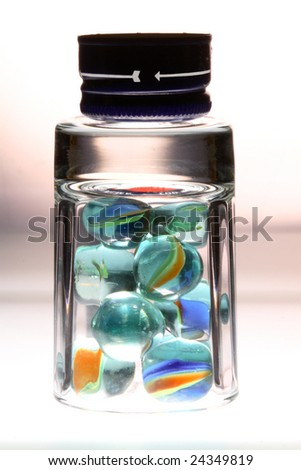 Composition with a glass, balls and a bottle cover. - stock photo