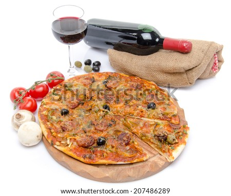 Composition with a pizza, a glass and a bottle of wine, isolated on white - stock photo