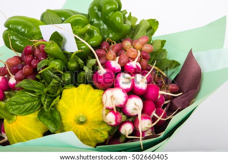 Composition with a variety of organic vegetables and fruits decoration in a gift bouquet