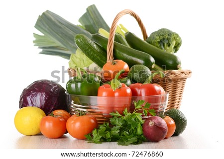 Composition with a variety of raw vegetables in wicker basket isolated on white - stock photo