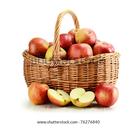 Composition with apples and wicker basket isolated on white