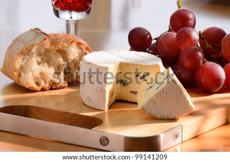 composition with blue cheese, grape, bread and red wine - stock photo
