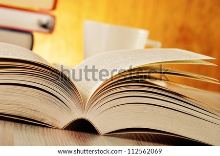 Composition with book on the table