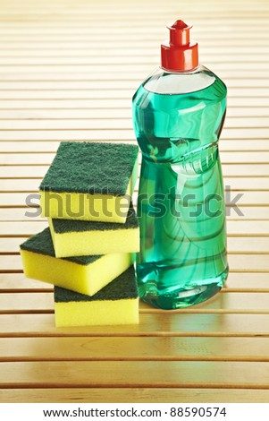 Composition with bottle scrourer and towel - stock photo