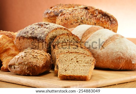 Composition with bread and rolls. Baking products. - stock photo