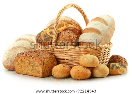 Composition with bread and rolls in wicker basket isolated on white