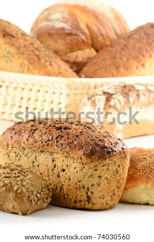 Composition with bread and rolls on kitchen table - stock photo