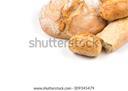 Composition with bread, buns and rolls isolated on white background